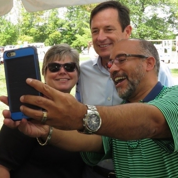Ed-Oquendo-and-Debbie-King-pose-for-a-selfie-with-CEO-Brian-Gragnolati