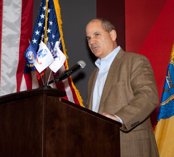 Carlos Rodriguez standing at a podium