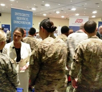 ADP recruiter talking with a small group of military job seekers dressed in fatigues
