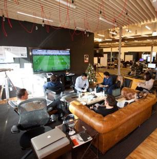 ADP associates seated in a break room area