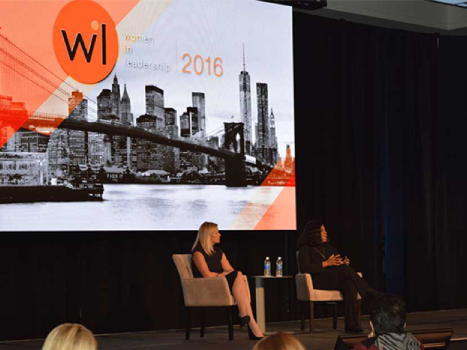 two women seated on a stage at the Women in Leadership 2016 conference