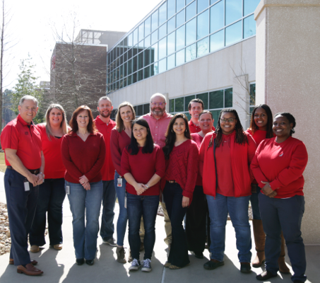 team of ADP Augusta, GA associates in red shirts and blue jeans