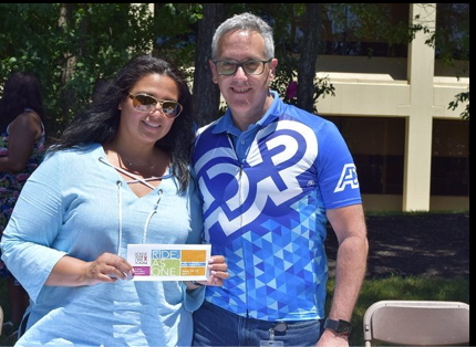 two ADP associates participating in Ride as One cycling event