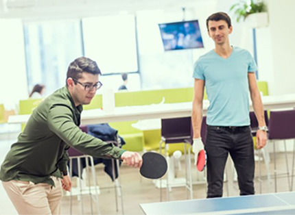 two ADP associates playing table tennis
