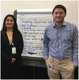 two ADP associates standing next to a whiteboard