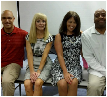 four ADP recruiters at a hiring event