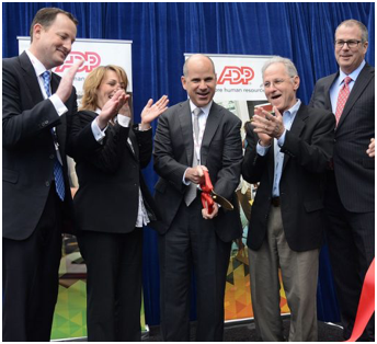 five ADP executives at a ribbon cutting ceremony