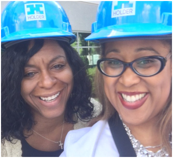 two ADP associates in blue construction hardhats
