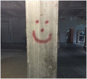 smiley face on a building post