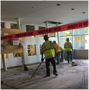 small group of construction workers working inside the ADP Orlando office building