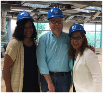 three ADP associates wearing blue construction hardhats inside the Orlando construction site