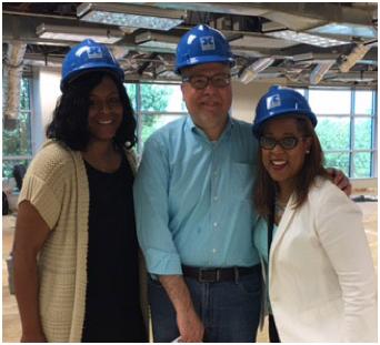 three ADP associates wearing blue construction hardhats inside the Orlando construction site