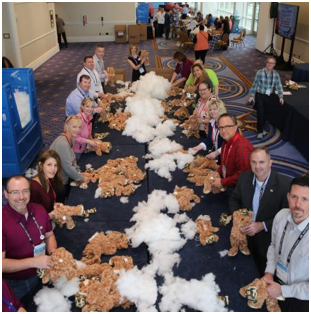 volunteer ADP associates stuffing toy bears