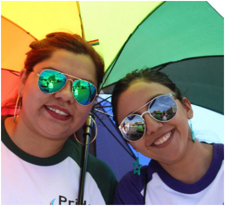 two ADP associates under a rainbow umbrella
