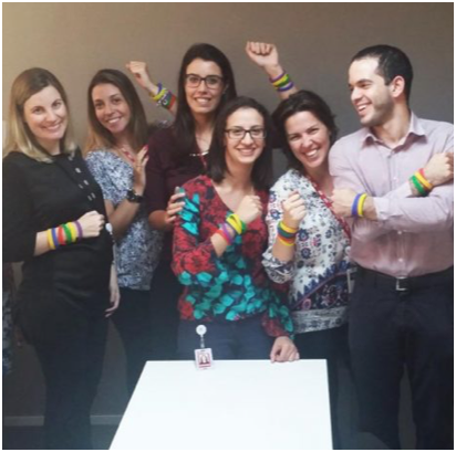 ADP HR team wearing colorful bracelets