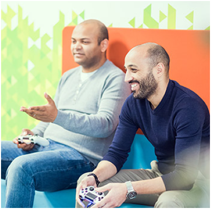 two ADP associates with game controllers in their hands