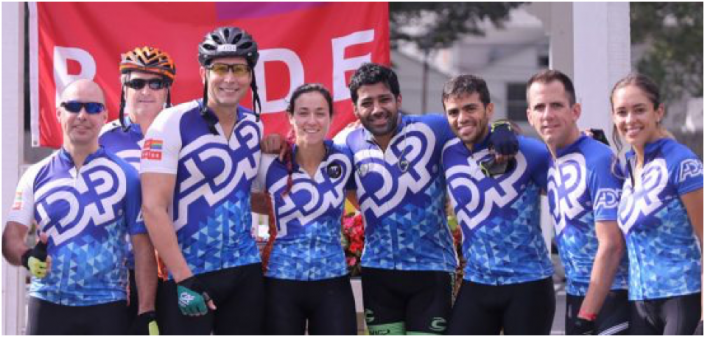 Group of ADP associates wearing ADP cycling gear