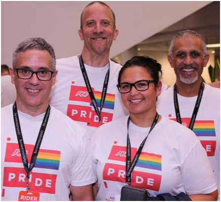 team of ADP associates wearing ADP Pride T-shirts