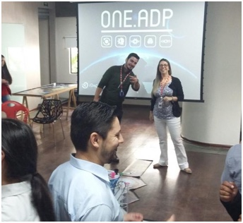 two ADP associates giving a presentation in front of screen