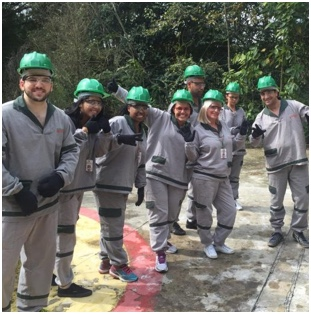 group of ADP associates in gray uniforms and green hardhats
