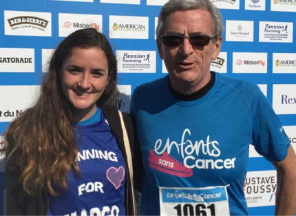 young woman and elderly man; participating in 'enfants sans cancer' event