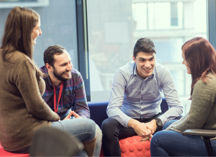 small team of ADP associates having a discussion