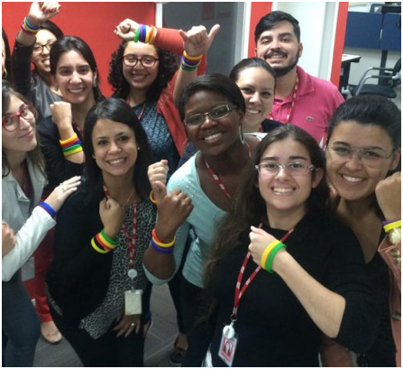 group of ADP associates wearing colorful bracelets