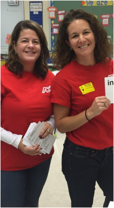 two ADP associates wearing red T-shirts