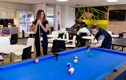 two ADP associates playing billiards in the ADP break room