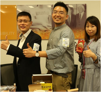 three ADP associates giving thumbs up with their hands