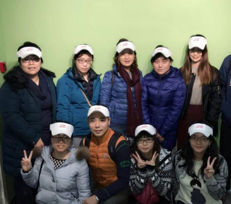 group of ADP associates wearing heavy coats and white sun visors