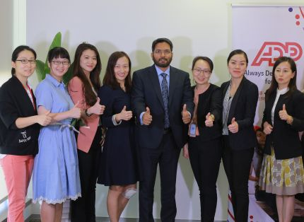Group of ADP associates gesturing approval with their thumbs up.