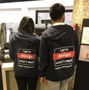 "two ADP associates wearing hoodies that read ""I get to design what's next"