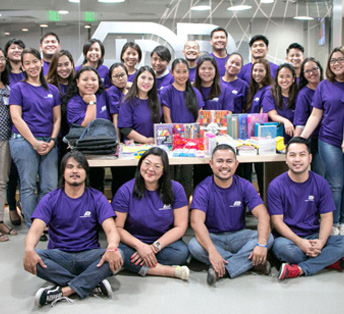 large group of ADP associates wearing purple T-shirts