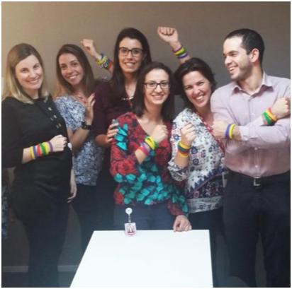 ADP HR team wearing colorful bracelets