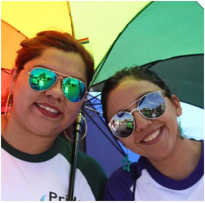 two ADP associates under a rainbow umbrella