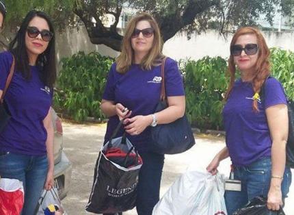 three women ADP associates wearing purple T-shirts and sunglasses