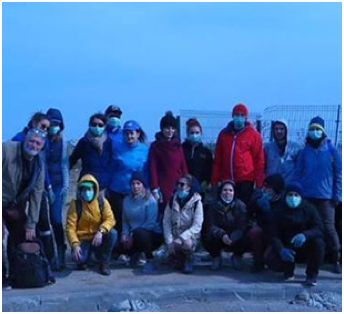 group of ADP associates wearing face masks and warm jackets