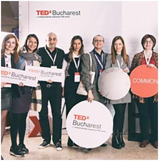group of ADP associates holding TEDx Bucharest signage
