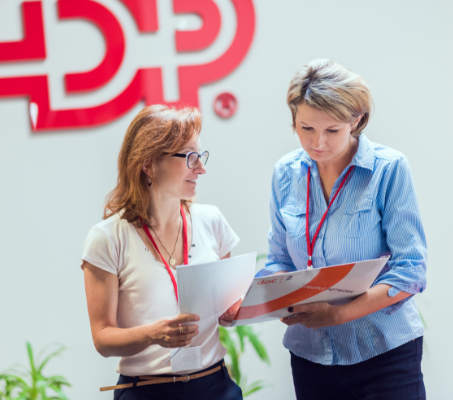 two ADP associates looking over some documents.