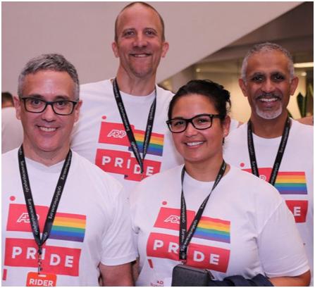 team of ADP associates wearing ADP Pride T-shirts