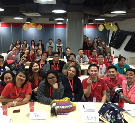 large group ADP Philippine associates seated in a conference room