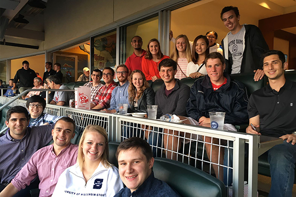 a group of Ecolab interns in the stands of a Minnesota Twins game