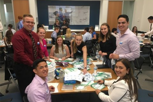 a group of Ecolab interns collaborate on a project