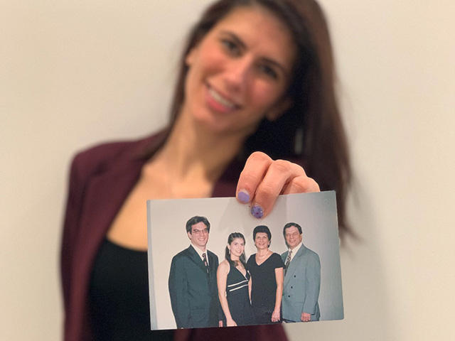 Woman holding picture of family