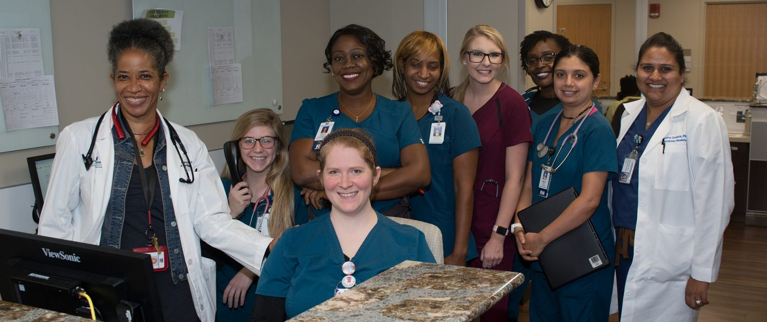 a group of smiling physicians