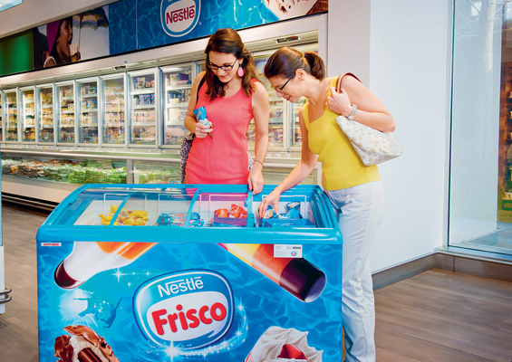 Nestle USA brand photo - woman choosing ice cream novelties from a standalone case