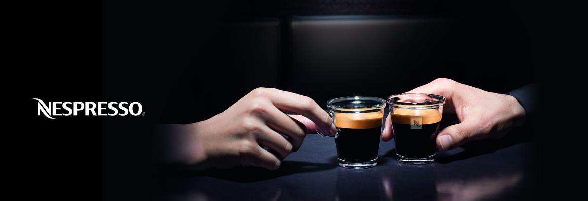 Nespresso Brand Image - hands holding cups of Nespresso
