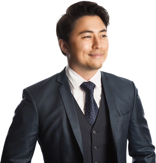 Confident, young male dressed in business suit looking into the distance.