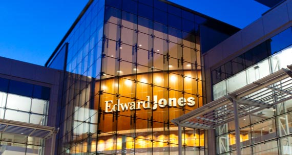Exterior night photo of an Edwards Jones headquarters building.